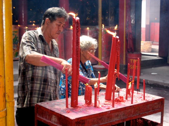 Red candles at an Indonesian Temple.