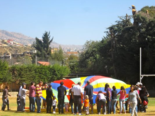 August 2012: New life, new school, new friends. School kids receive their 'welcome' with a traditional 'Salteñada'.